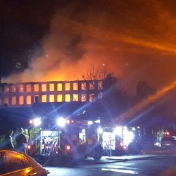 Picture Of Huge fire breaks out at derelict mill in Huddersfield